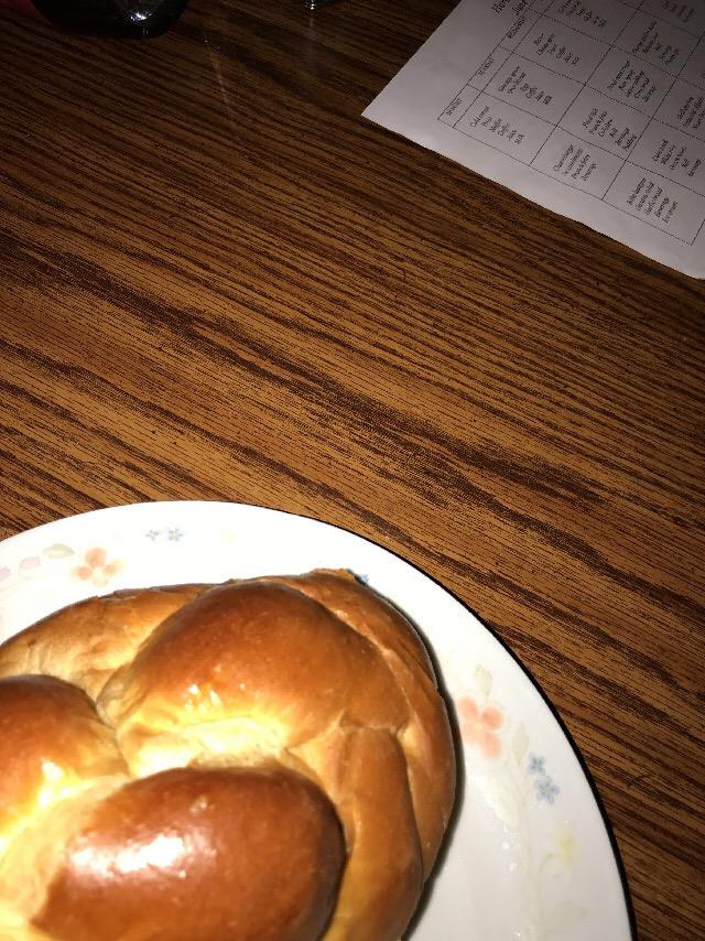 A freshly baked loaf of challah on a plate